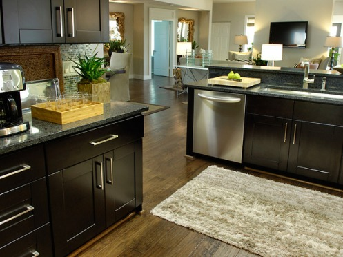 modern kitchen grey mosauc tiles black clean surfaces rug