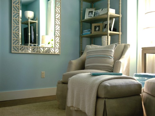 light soft baby blue room walls beige chair white chinese lattice mirror