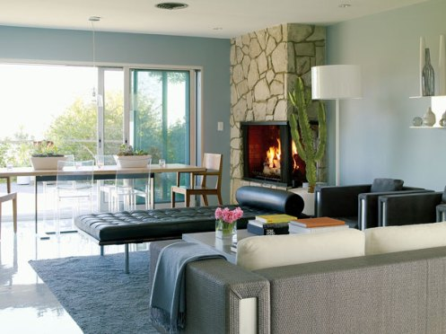 light blue retro modern living room with fire place
