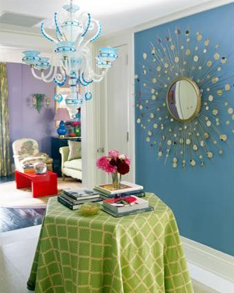 blue and green room, big sun mirror, white and blue chandelier, colorful