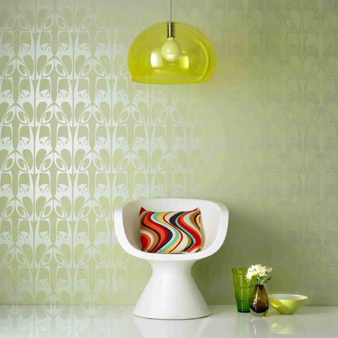 Green retro room pearl wallpaper with retro pattern, lamp and chair