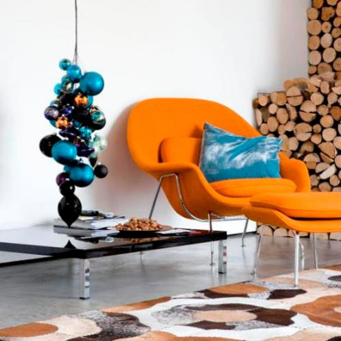 modern lounge nook, white with orange chair and blue