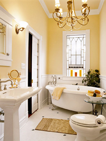 soft yellow and white country cottage style sunny bathroom with chandelier