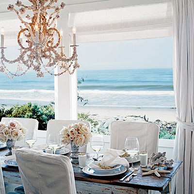 beachy white beach tehme dining room with sea shell chandelier