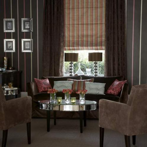 dramatic rich brown living room lounge with pink, modern lamps and coffee table
