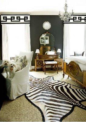 posh black and white modern bedroom, zebra skin rug, chandelier