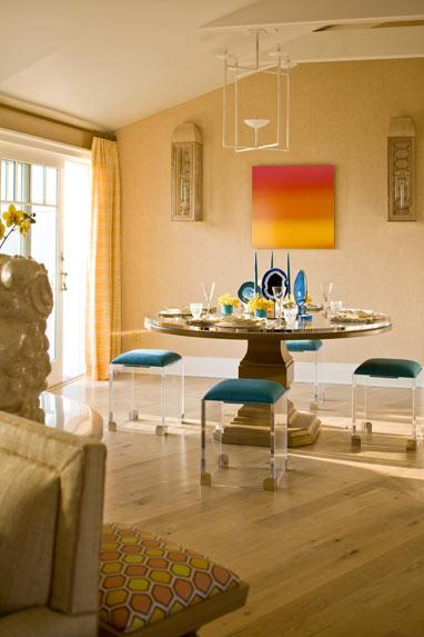 colorful dining room lucite chairs, blue red, yellow and beige