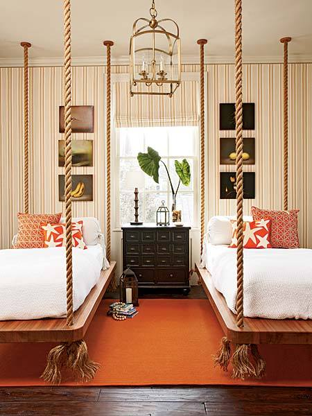 orange and white nautical style guest bedroom ceiling mounted beds