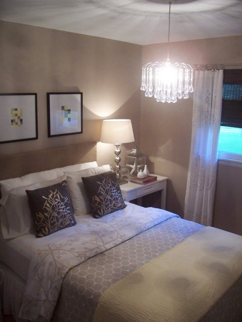 beige bedroom with chandelier