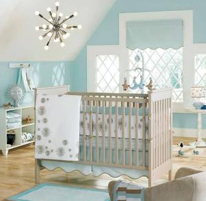 Baby bedroom design with unique chandelier