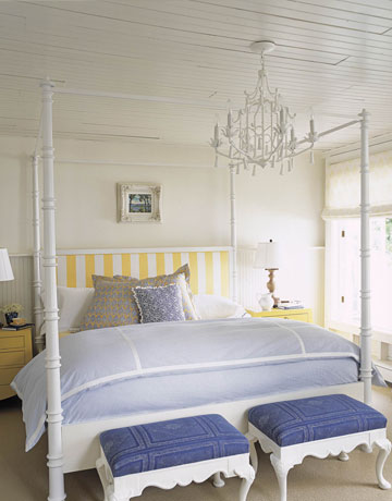 White, blue and yellow bedroom with chandelier