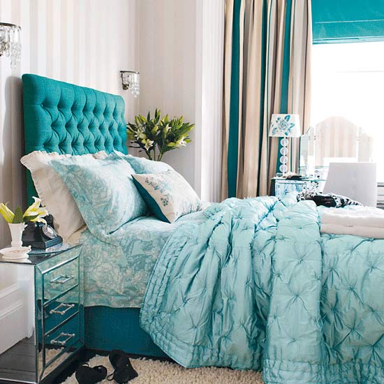 Classic-style-bedroom-in-blue-with-detailed-decorated-furniture-and-blue-cloth-covered-bed