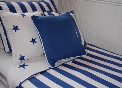 blue and white bed sheets nautical style bedroom