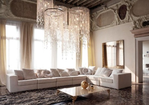 cream and white living room lounge with chandelier and large sofa