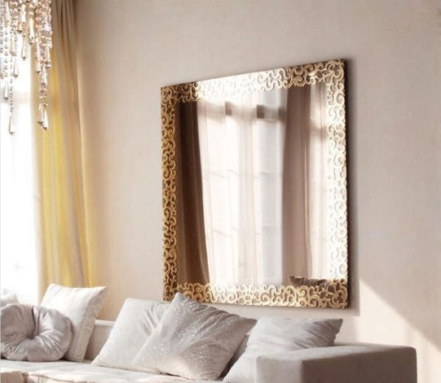 large square mirror with golden frame and glass
