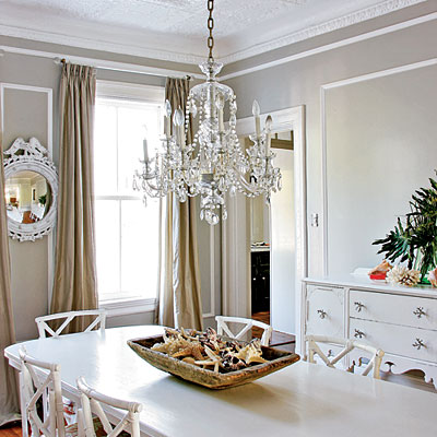 beachy glamour style dining room white chandelier round mirror