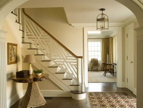 tan and cream sophisticated hall foyer stairway