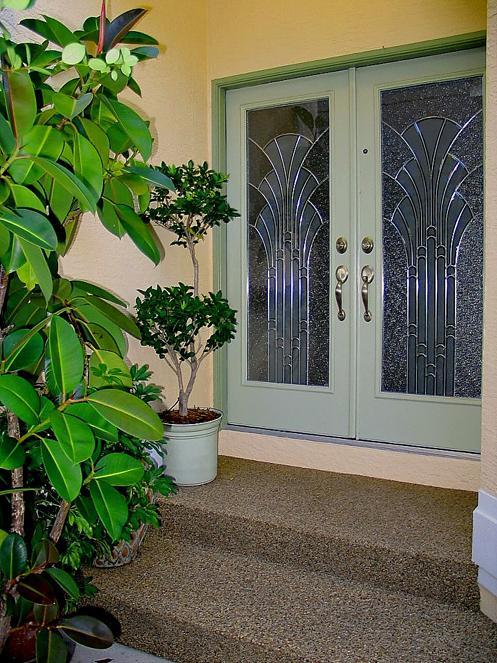 beautiful coastal home green glass front door