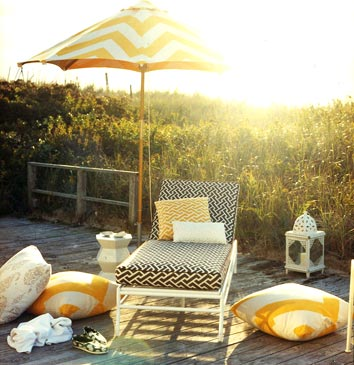 white and yellow mimosa graphic print parasol and patio furniture