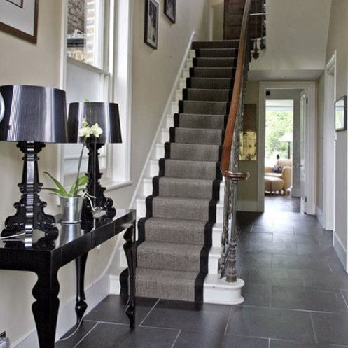 modern hall with entry and black and white stairways