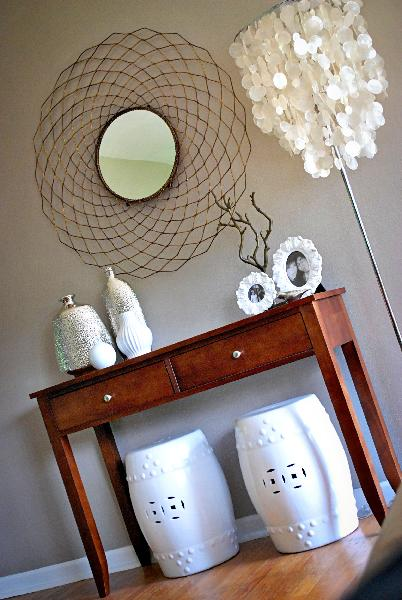 beige tan brown modern hall entry way, round mirror, sea shell floor lamp