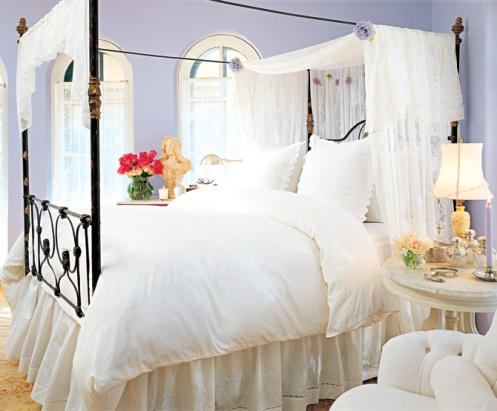 lilac and white romantic country master bedroom bed with pilar frame