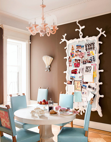 brown blue turquoise white funky modern dinind room with pink chandelier