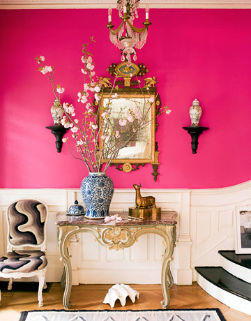 pink and white funky modern hall hallway foryer entry with chandelier