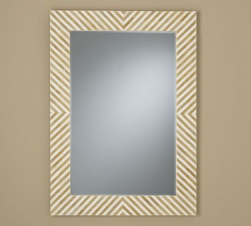 beige and white geometrical mirror frame mirror