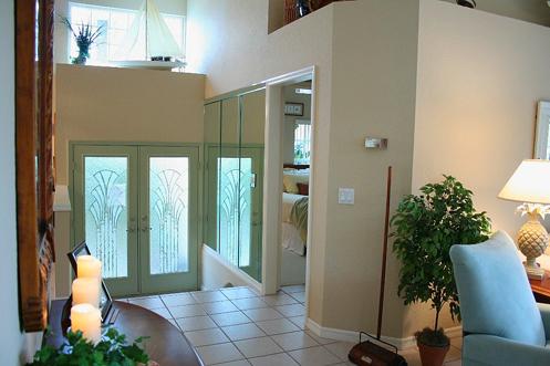 beige and white coastal home foyer hall