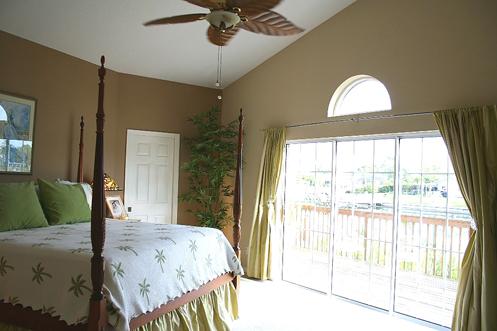 beige white green coastal beachy home master bedroom