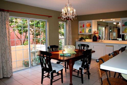 beige and white coastal kitchen with chandelier