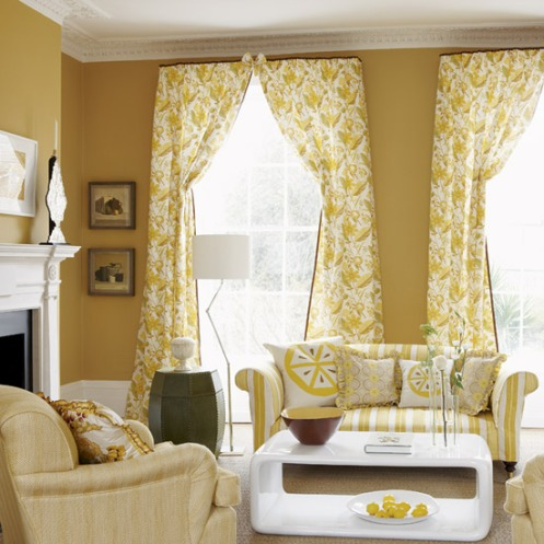 mustard yellow living room lounge, stripy sofa, lemon pillows, floral curtains and modern white coffee table