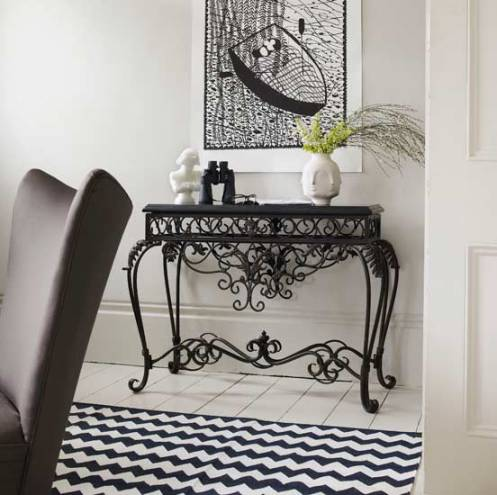 black and white hallway black iron side table
