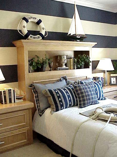 nautical interior bedroom, blue and white stripes, boat, bed, life saver