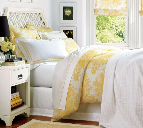 white and yellow sunny bedroom