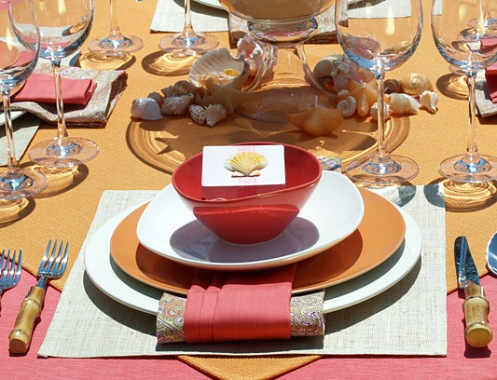 red orange beachy table setting