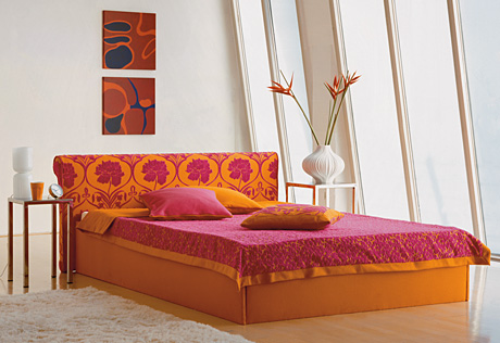 pink and orange bed in white bedroom