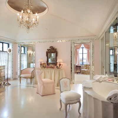 light soft pink and white classy posh bathroom with chandelier