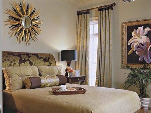Posh modern bedroom with sunmirror and painting art