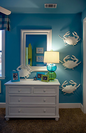 blue and white modern beach style home room white porcelain crabs, white dresser