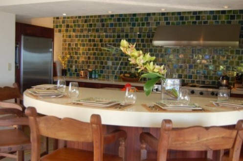 tropical green kitchen with dining area