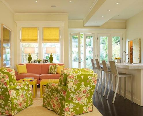 cream living room with acid green and pink, florar winged chairs