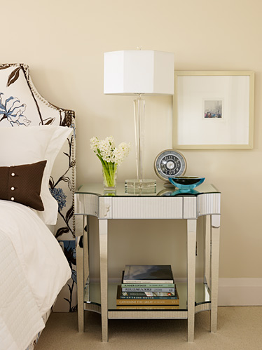 cream bedroom with mirror night stand