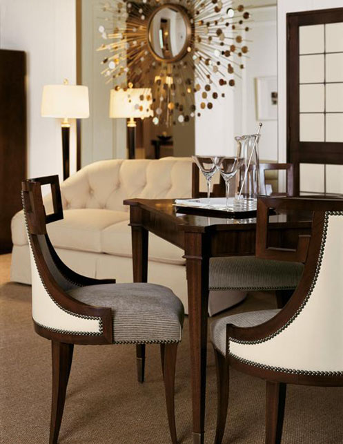 posh interior dining room chairs and sunburst mirror