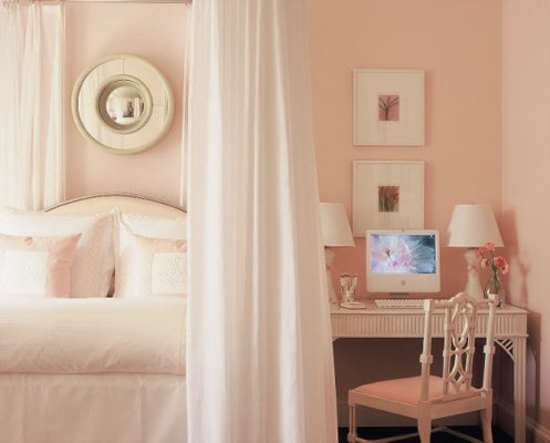 soft pink and white bedroom with mirror and vanity
