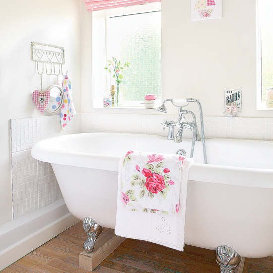 Modern-style-bathroom-with-white-walls-bathtub-white-bathrobe-with-pink-red-flowers