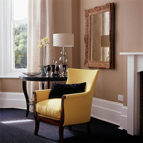 modern room yellow sofa black floor tan walls