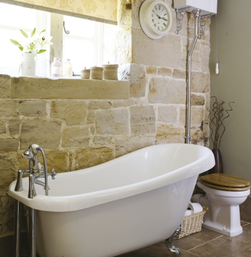 rustic bathroom with faw stone wall and free standing baththub