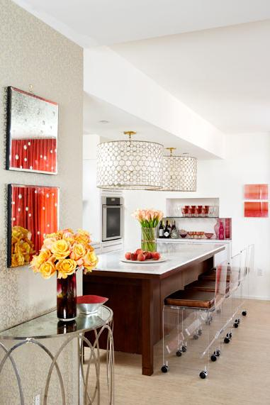 white and coral kitchen with chandelier